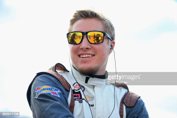 Garrett Smithley driver of the Heroes Haven Chevrolet stands on the grid during qualifying for the NASCAR XFINITY Series Use Your Melon Drive Sober...