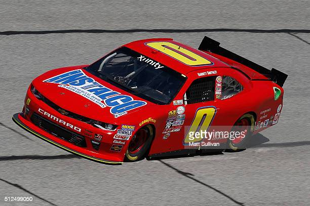 Garrett Smithley driver of the Instalco Chevrolet practices for the NASCAR XFINITY Series Heads Up Georgia 250 at Atlanta Motor Speedway on February...