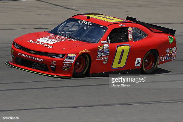 Garrett Smithley driver of the teamjdmotorsportscom Chevrolet drives during practice for the NASCAR XFINITY Series Menards 250 at Michigan...