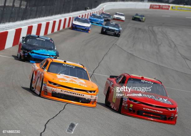 Garrett Smithley driver of the teamjdmotorsportscom Chevrolet leads David Starr driver of the Striping Technology Chevrolet during the NASCAR XFINITY...