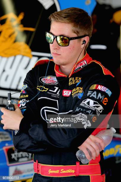 Garrett Smithley driver of the teamjdmotorsportscom Chevrolet stands in the garage area during practice for the NASCAR Xfinity Series Rinnai 250 at...