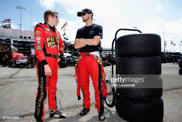 Garrett Smithley driver of the teamjdmotorsportscom Chevrolet talks with Harrison Rhodes driver of the teamjdmotorsportscom Chevrolet during practice...