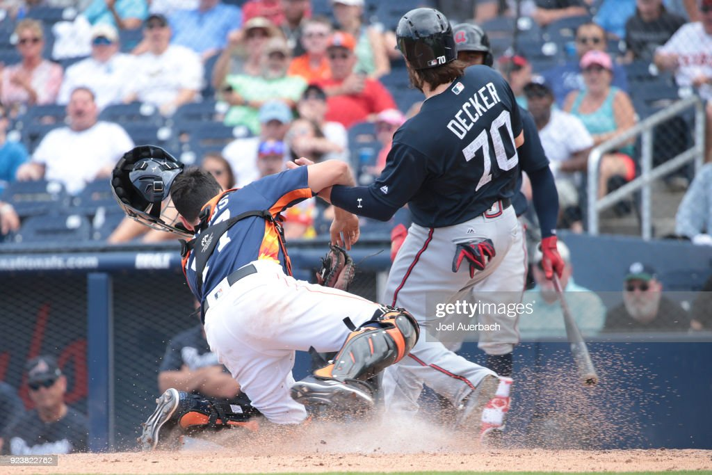 Garrett Stubbs of the Houston Astros tags out Jaff Decker #70 of the Atlanta Braves in the fifth inning during a spring training game at The Ballpark of the Palm Beaches on February 24, 2018 in West Palm Beach, Florida.
