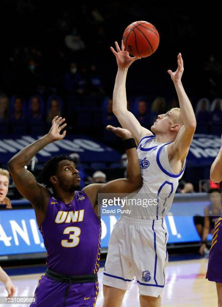 Garrett Sturtz of the Drake Bulldogs battles for ma rebound with Tywhon Pickford of the Northern Iowa Panthers in the first half of play at Knapp...