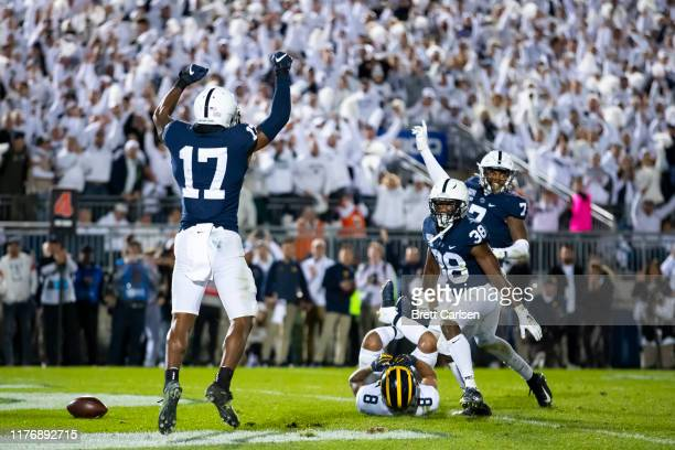 Garrett Taylor Lamont Wade and Jaquan Brisker of the Penn State Nittany Lions celebrate a fourth down stop in the final minutes of the game against...