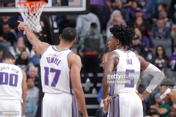 Garrett Temple and De'Aaron Fox of the Sacramento Kings look on during the game against the Milwaukee Bucks on November 28 2017 at Golden 1 Center in...