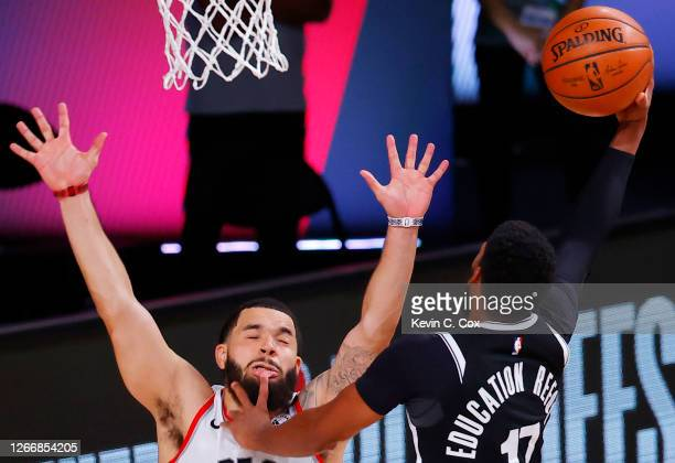 Garrett Temple of the Brooklyn Nets goes up for a shot against Fred VanVleet of the Toronto Raptors during the third quarter in Game One of the...
