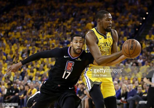 Garrett Temple of the LA Clippers tries to steal the ball from Kevin Durant of the Golden State Warriors during Game Two of the first round of the...