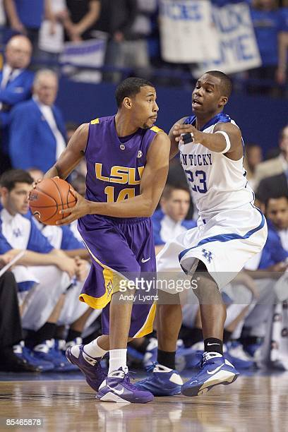 Garrett Temple of the LSU Tigers looks to pass the ball against Jodie Meeks of the Kentucky Wildcats during the SEC game at Rupp Arena on February 28...