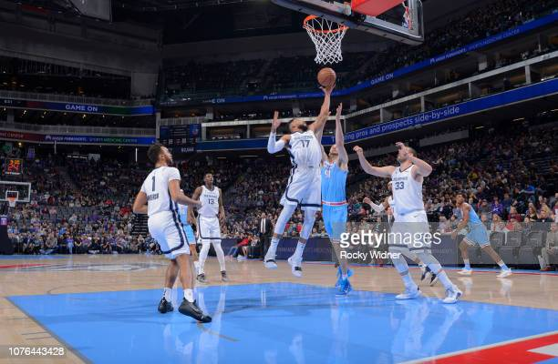 Garrett Temple of the Memphis Grizzlies rebounds against the Sacramento Kings on December 21 2018 at Golden 1 Center in Sacramento California NOTE TO...