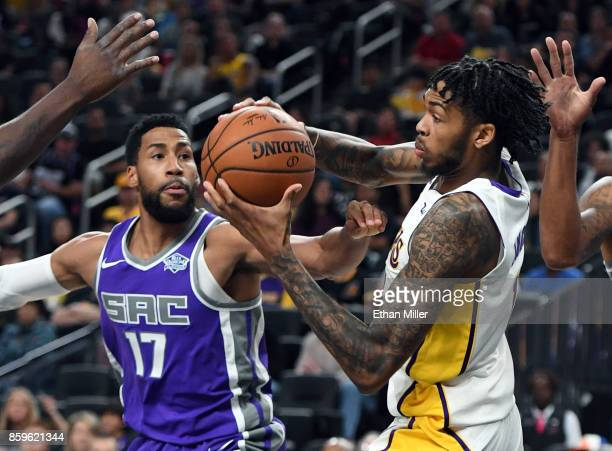Garrett Temple of the Sacramento Kings and Brandon Ingram of the Los Angeles Lakers fight for a rebound during their preseason game at TMobile Arena...