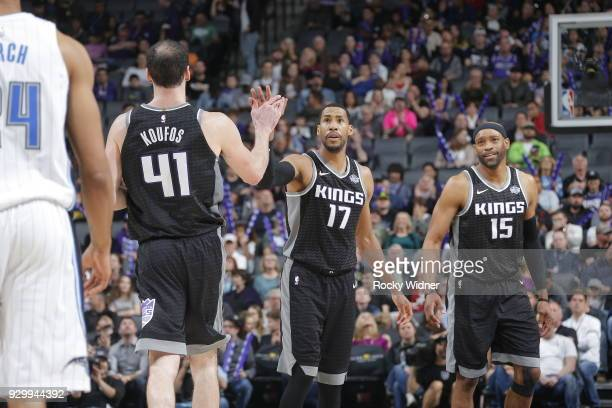 Garrett Temple of the Sacramento Kings and Kosta Koufos of the Sacramento Kings high five during the game against the Orlando Magic on March 9 2018...