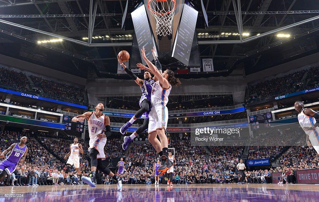 Garrett Temple #17 of the Sacramento Kings goes up for the shot against Steven Adams #12 of the Oklahoma City Thunder on November 23, 2016 at Golden 1 Center in Sacramento, California.
