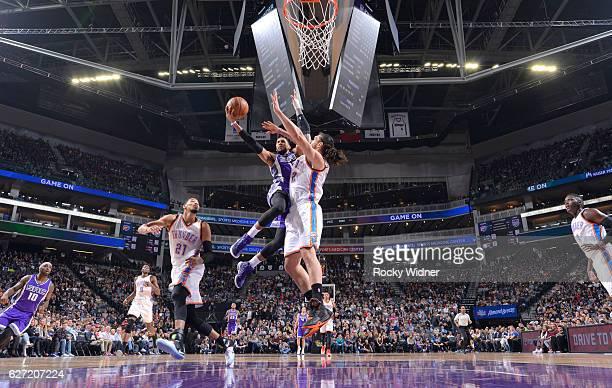 Garrett Temple of the Sacramento Kings goes up for the shot against Steven Adams of the Oklahoma City Thunder on November 23, 2016 at Golden 1 Center...