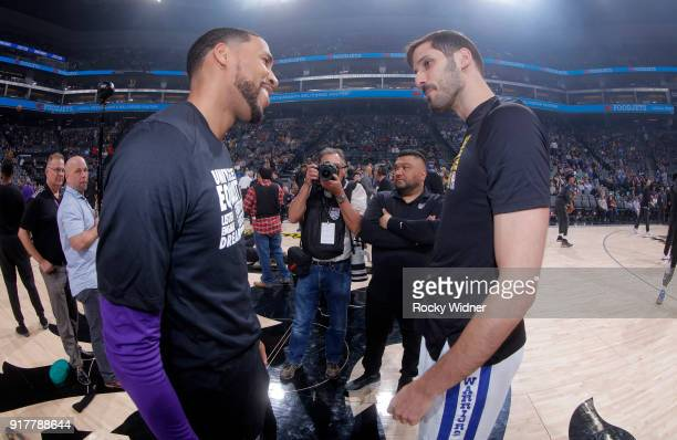 Garrett Temple of the Sacramento Kings greets Omri Casspi of the Golden State Warriors prior to the game on February 2 2018 at Golden 1 Center in...