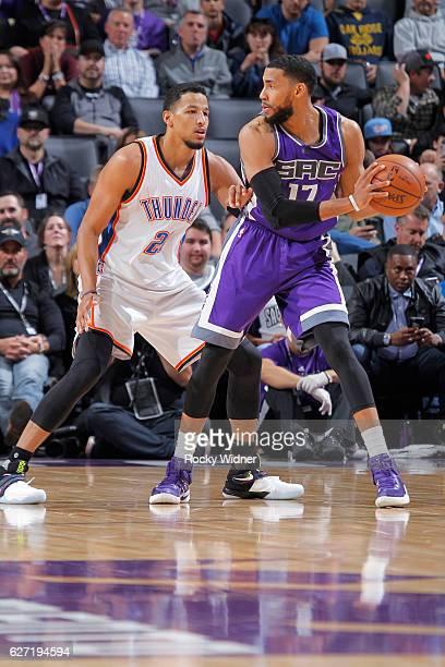 Garrett Temple of the Sacramento Kings handles the ball against Andre Roberson of the Oklahoma City Thunder on November 23 2016 at Golden 1 Center in...