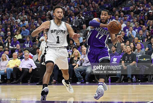 Garrett Temple of the Sacramento Kings passes the ball by Kyle Anderson of the San Antonio Spurs during the first quarter of an NBA basketball game...