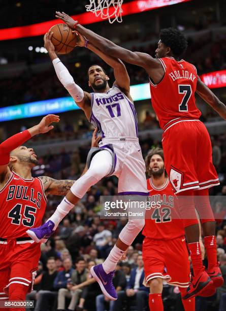 Garrett Temple of the Sacramento Kings puts up a shot between Denzel Valentine and Justin Holiday of the Chicago Bulls at the United Center on...