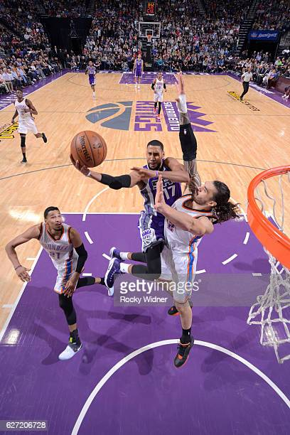Garrett Temple of the Sacramento Kings shoots a layup against Steven Adams of the Oklahoma City Thunder on November 23 2016 at Golden 1 Center in...