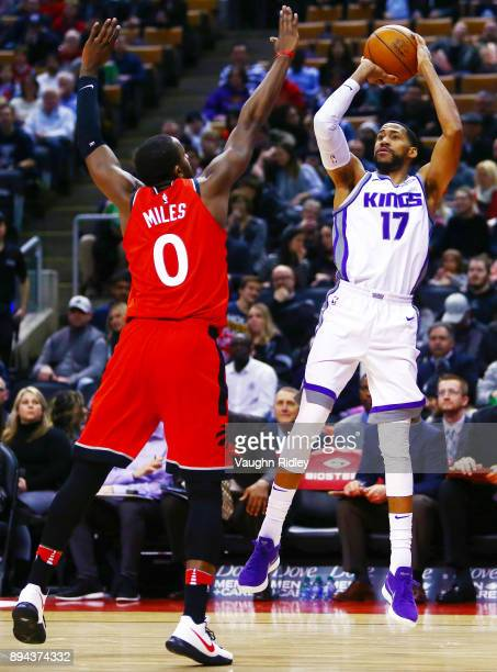 Garrett Temple of the Sacramento Kings shoots the ball as CJ Miles of the Toronto Raptors defends during the first half of an NBA game at Air Canada...