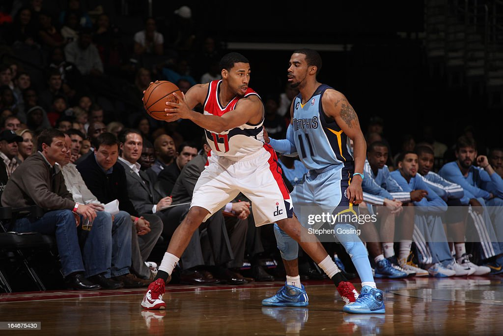 Garrett Temple #17 of the Washington Wizards controls the ball against Mike Conley #11 of the Memphis Grizzlies at the Verizon Center on March 25, 2013 in Washington, DC.