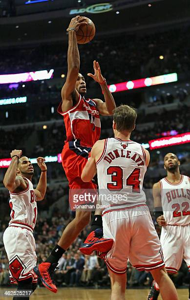 Garrett Temple of the Washington Wizards crashes into Mike Dunleavy of the Chicago Bulls at the United Center on January 13 2014 in Chicago Illinois...
