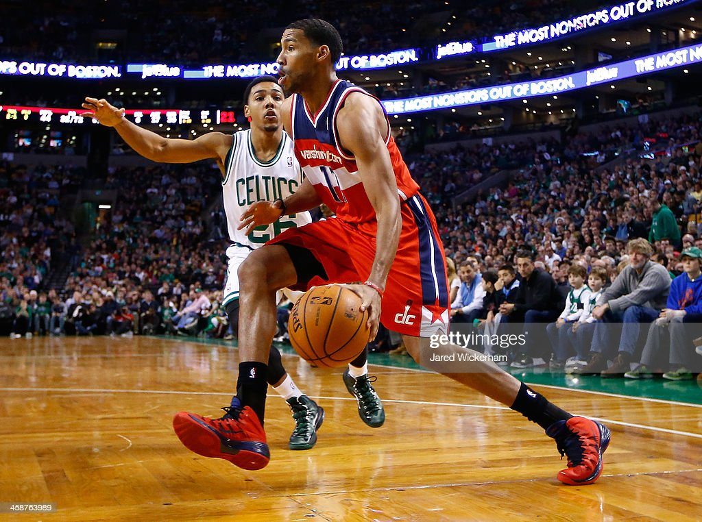Garrett Temple #17 of the Washington Wizards drives to the basket past Phil Pressey #26 of the Boston Celtics in the second half during the game at TD Garden on December 21, 2013 in Boston, Massachusetts.
