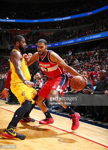Garrett Temple of the Washington Wizards handles the ball against the Cleveland Cavaliers during a game at the Verizon Center on November 21 2014 in...