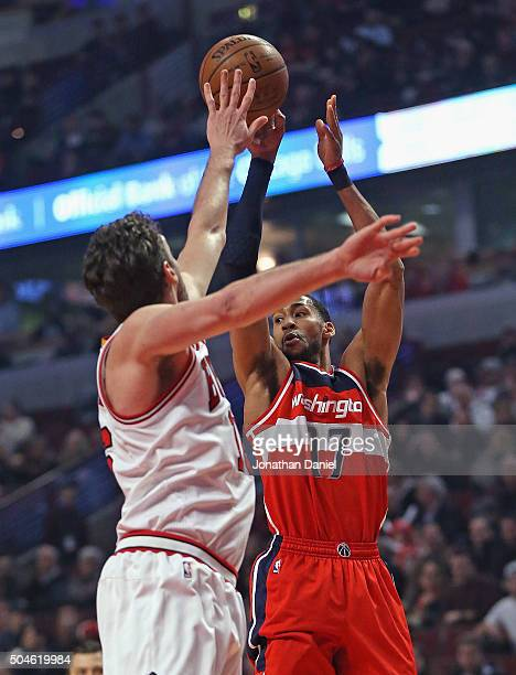 Garrett Temple of the Washington Wizards passes over Pau Gasol of the Chicago Bulls at the United Center on January 11 2016 in Chicago Illinois NOTE...