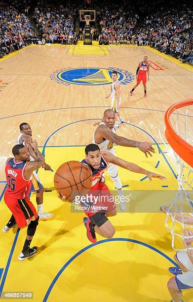 Garrett Temple of the Washington Wizards shoots against Marreese Speights of the Golden State Warriors on January 28 2014 at Oracle Arena in Oakland...