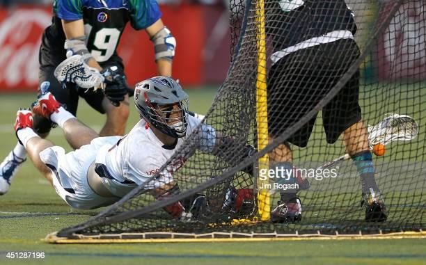 Garrett Thul of Team USA scores on Jordan Burke of Team MLL in the second quarter during the 2014 MLL All Star Game at Harvard Stadium on June 26,...