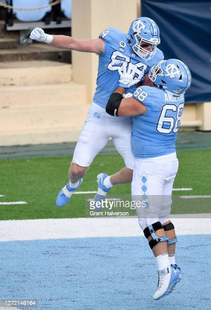 Garrett Walston celebrates with teammate Brian Anderson of the North Carolina Tar Heels after scoring a touchdown against the Syracuse Orange during...