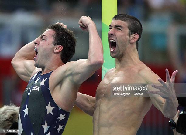 Garrett WeberGale and Michael Phelps of the United States celebrate finishing the Men's 4 x 100m Freestyle Relay Final in first place to win the gold...