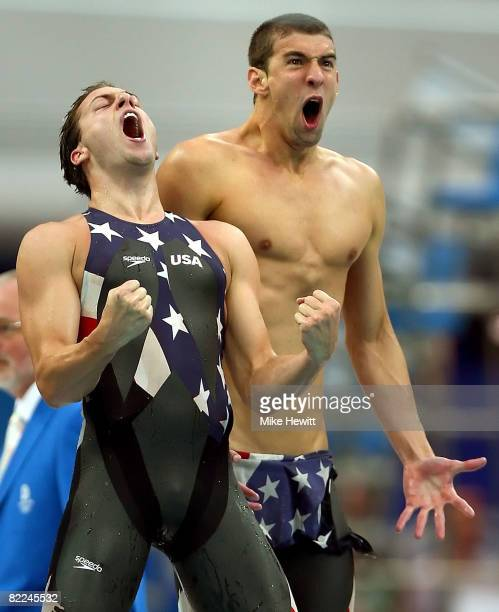 Garrett Weber-Gale and Michael Phelps of the United States celebrate finishing the Men's 4 x 100m Freestyle Relay Final in first place to win the...