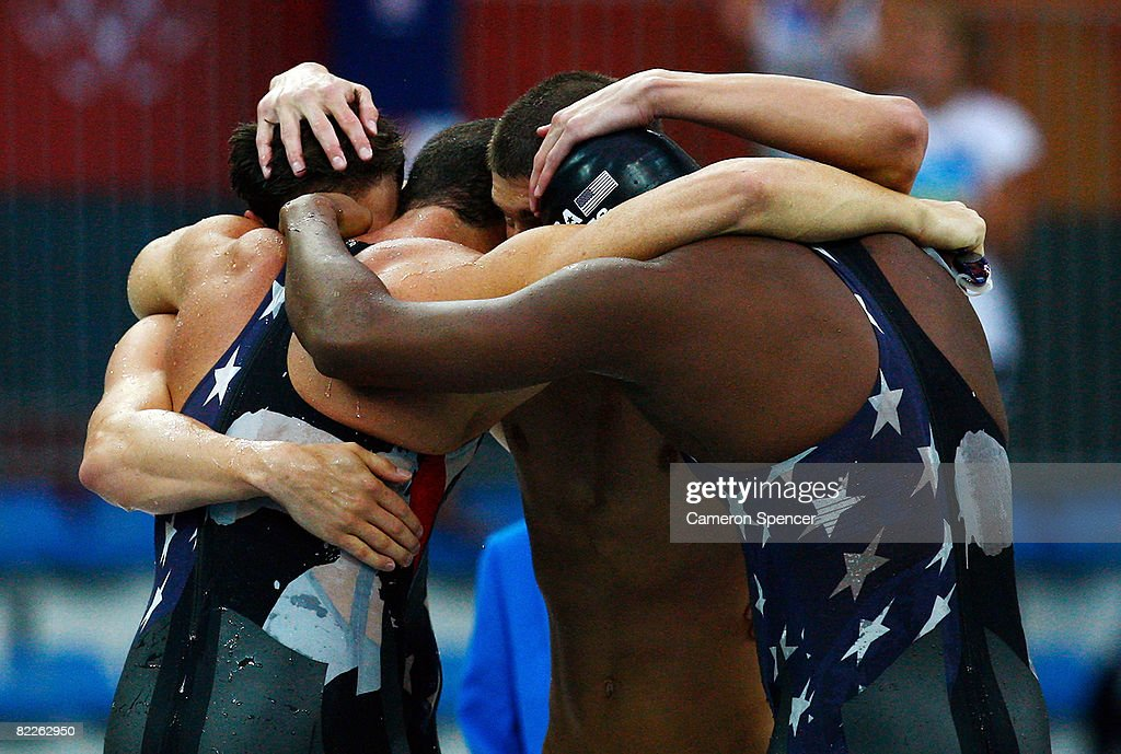 Garrett Weber-Gale, Jason Lezak, Michael Phelps and Cullen Jones of the United States celebrate finishing the Men's 4 x 100m Freestyle Relay Final in first place and to win the gold medal held at the National Aquatics Center on Day 3 of the Beijing 2008 Olympic Games on August 11, 2008 in Beijing, China.