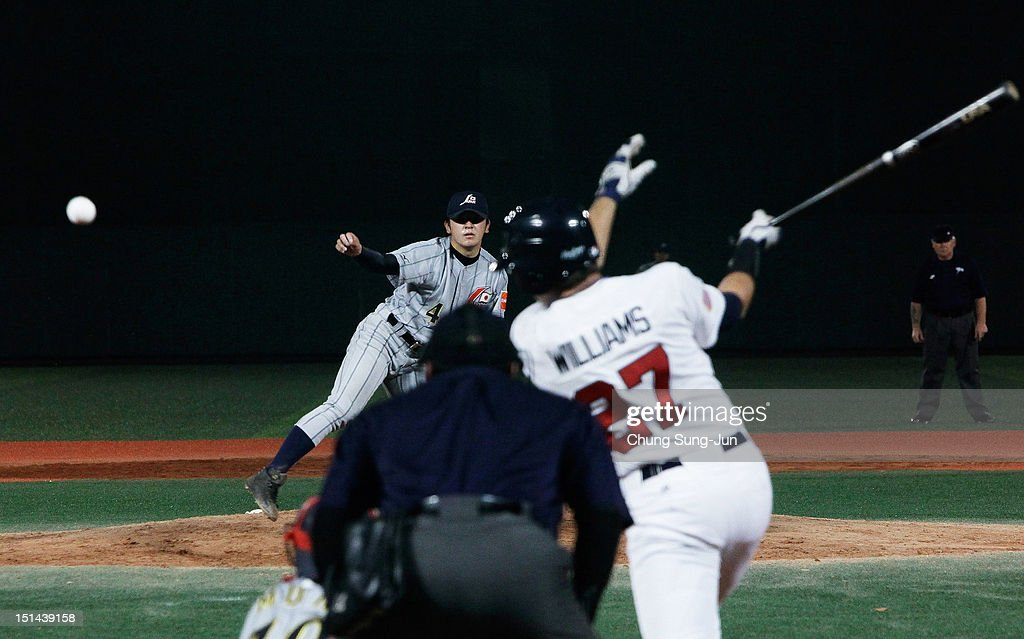 Garrett Williams of United States bats as Yu Kambara of Japan pitches during the 18U Baseball World Championship match between Japan and the United States at Mokdong stadium on September 7, 2012 in Seoul, South Korea.
