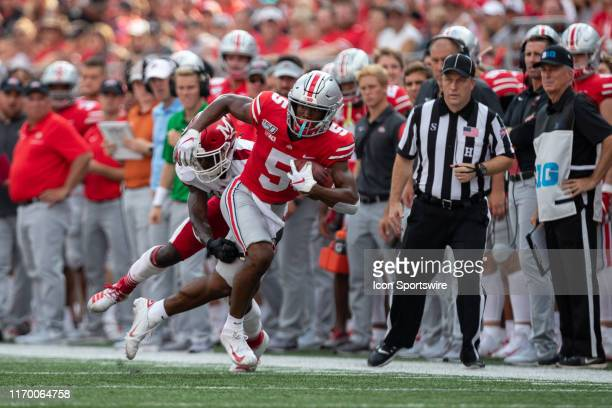 Garrett Wilson of the Ohio State Buckeyes runs after a catch during game action between the Ohio State Buckeyes and the Miami Redhawks on September...