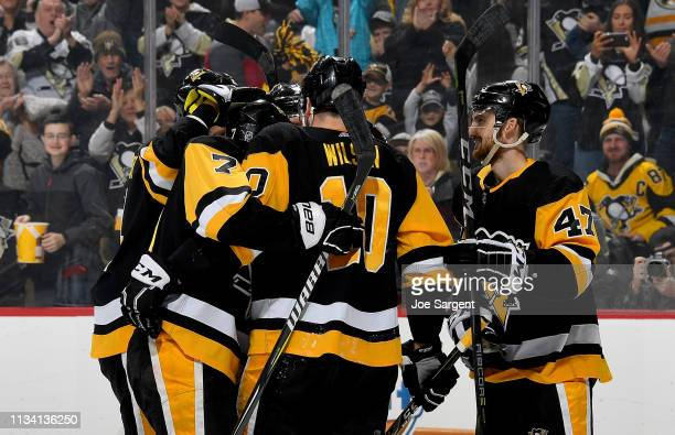 Garrett Wilson of the Pittsburgh Penguins celebrates his first period goal against the Carolina Hurricanes at PPG Paints Arena on March 31 2019 in...