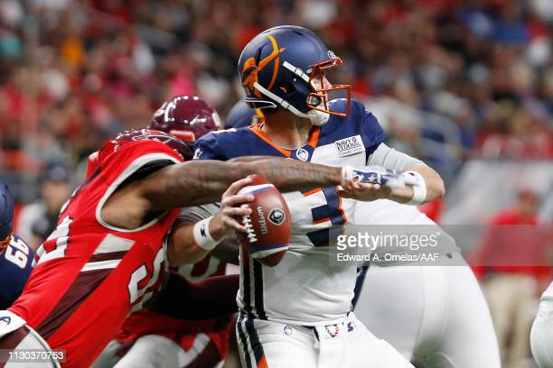 Garrett Gilbert of the Orlando Apollos fumbles the ball as he is sacked by Jayrone Elliott of the San Antonio Commanders during the third quarter in...
