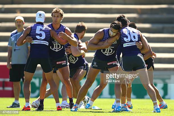 Garrick Ibbotson and Matt De Boer together with Matthew Pavlich and Alex Silvagni warm up during a Fremantle Dockers AFL training session at...