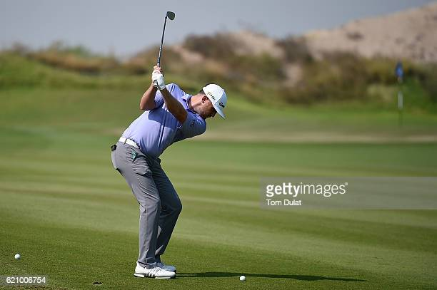 Garrick Porteous of England hits an approach shot on the 1st hole during day three of the NBO Golf Classic Grand Final at Al Mouj Golf on November 4...