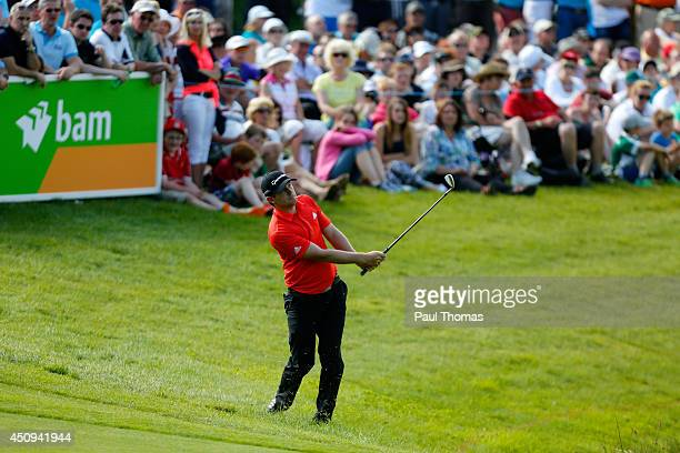 Garrick Porteous of England plays a shot on the 18th hole during the second round of The Irish Open at Fota Island resort on June 20 2014 in Cork...