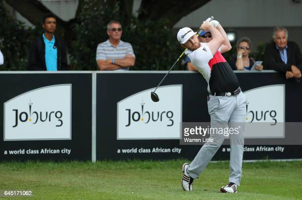 Garrick Porteous of South Africa tees off on the first hole during the third round of the Joburg Open at Royal Johannesburg and Kensington Golf Club...