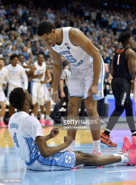 Garrison Brooks and Brandon Robinson of the North Carolina Tar Heels react during the first half of their game against the Virginia Tech Hokies at...