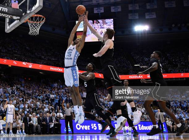 Garrison Brooks of the North Carolina Tar Heels battles Sam Waardenburg of the Miami Hurricanes for a rebound during their game at the Dean Smith...