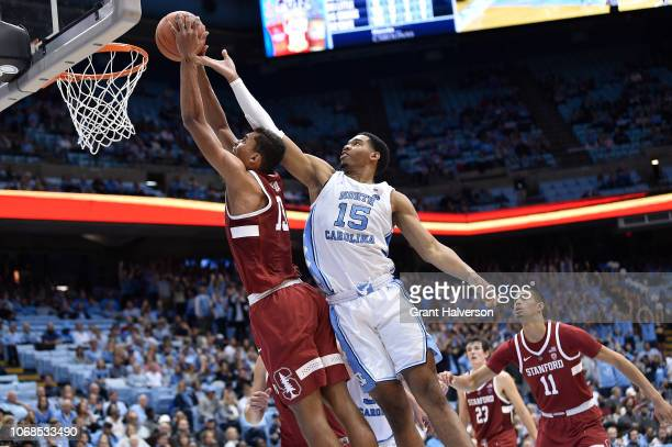 Garrison Brooks of the North Carolina Tar Heels defends a shot by Oscar da Silva of the Stanford Cardinal during their game at the Dean Smith Center...
