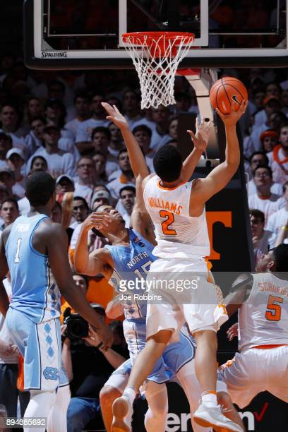 Garrison Brooks of the North Carolina Tar Heels defends against Grant Williams of the Tennessee Volunteers in the second half of a game at...