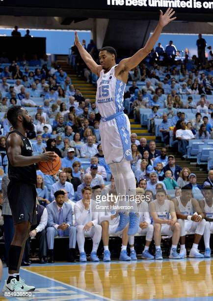 Garrison Brooks of the North Carolina Tar Heels defends an inbounds pass by Jordan Cornish of the Tulane Green Waveduring their game at the Dean...