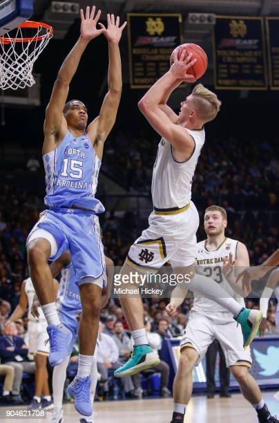 Garrison Brooks of the North Carolina Tar Heels defends as Rex Pflueger of the Notre Dame Fighting Irish shoots at Purcell Pavilion on January 13...