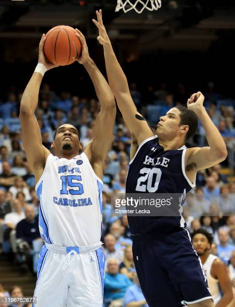 Garrison Brooks of the North Carolina Tar Heels drives to the basket against Paul Atkinson of the Yale Bulldogs during their game at Dean Smith...
